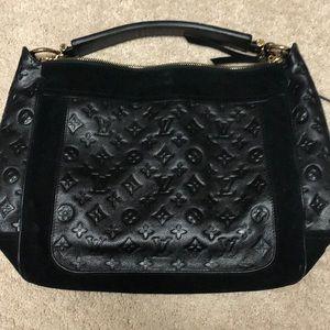 Louis Vuitton black embossed logo leather purse